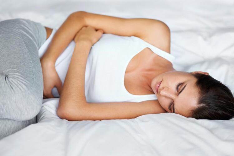 02-menstrual-pains-heat-or-ice-504135835-Yuri_Arcurs.jpg