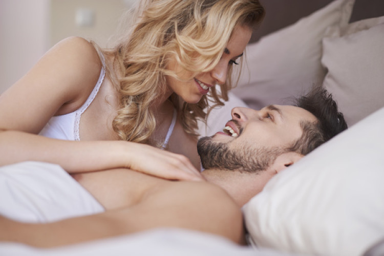 Talking-sweet-couples-in-bed-Stock-Photo.jpg