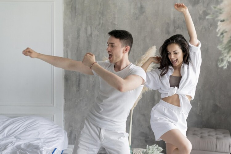 front-view-happy-couple-dancing-home_23-2148561013.jpg