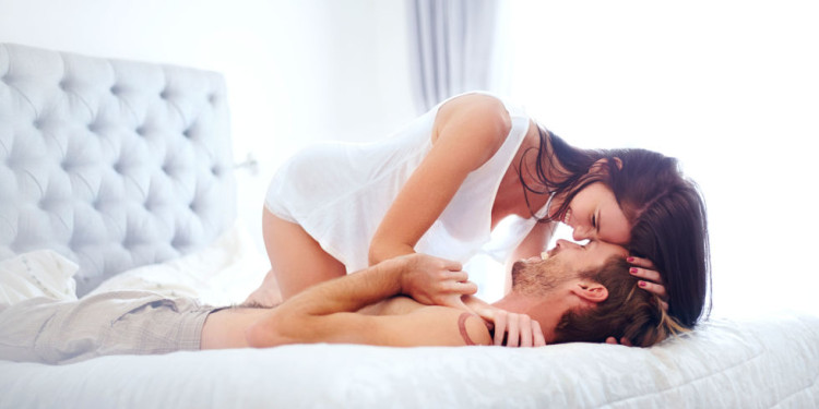 landscape-1475587869-couple-being-intimate-on-bed.jpg