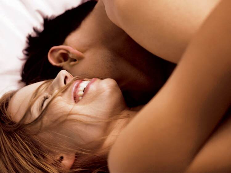sex-love-life-2013-11-02-woman-laughing-in-bed-main.jpg
